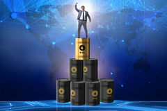 The businessman on top of oil barrels Stock Image