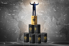 The businessman on top of oil barrels Stock Images