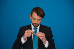 Businessman topping up his e-cigarette with e-liquid Royalty Free Stock Images