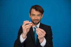 Businessman topping up his e-cigarette with e-liquid Royalty Free Stock Photo