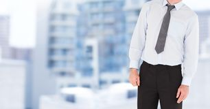 Businessman Torso against building background Stock Image