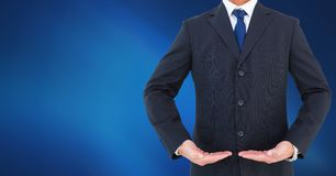Businessman Torso showing something against neutral dark blue background. Digital composite of Businessman Torso showing something against neutral dark blue royalty free stock photos