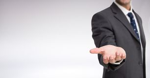 Businessman Torso who is stretching his hand against a neutral background Royalty Free Stock Images