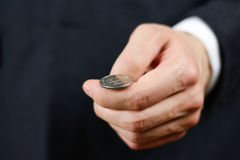 Businessman tossing a coin. Heads or tails. Close up Royalty Free Stock Photos
