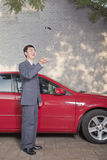 Businessman Tossing His Car Keys into the Air Royalty Free Stock Photography