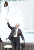 Businessman tossing his hat Stock Photos