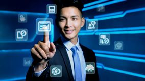 Businessman with icon. Businessman touch business icon on blue background Stock Photo