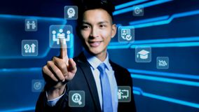 Businessman with icon. Businessman touch business icon on blue background Stock Photos