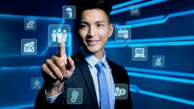 Businessman with icon. Businessman touch business icon on blue background Royalty Free Stock Photography