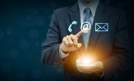 Businessman touch email icon on hand. Communication concept Royalty Free Stock Image