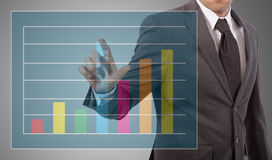 Businessman touch graph Royalty Free Stock Photography