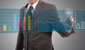 Businessman touch graphs Royalty Free Stock Images