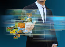 Businessman touch green Earth in hands Stock Photo