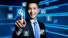 Businessman with icon. Businessman touch hr icon on blue background Stock Images