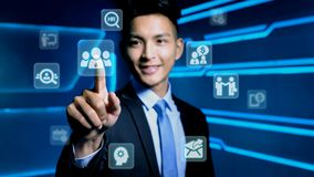 Businessman with icon. Businessman touch hr icon on blue background Royalty Free Stock Photography