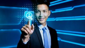 Businessman with icon. Businessman touch hr icon on blue background Stock Photos