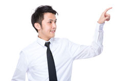 Businessman touch on imaginary panel Stock Image
