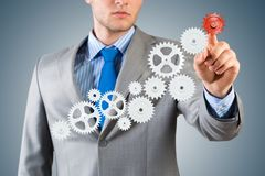 Businessman touch the mechanism Royalty Free Stock Images