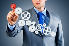 Businessman touch the mechanism Stock Images