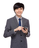 Businessman touch on mobile phone Royalty Free Stock Photo