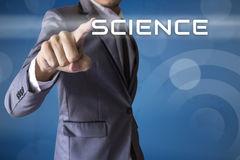 Businessman touch Science conceptual Royalty Free Stock Image
