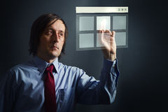 Businessman with touch screen Stock Image