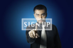Businessman touch screen button Stock Images