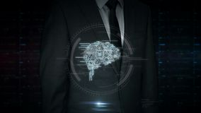 Businessman touch screen with cyber brain symbol hologram. A businessman in a suit touch the screen with cybernetic brain hologram. Man using hand on virtual stock video footage