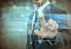 Businessman  touch screen interface in the old paper Stock Photo