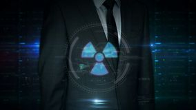 Businessman touch screen with nuclear energy symbol hologram
