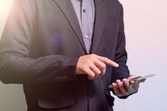 Businessman touch screen smart phone. Businessman hand hold and touch screen smart phone, mobile Royalty Free Stock Images