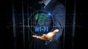 Businessman touch screen with wi-fi hologram. A businessman in a suit touch the screen with wi-fi symbol hologram. Man using virtual display interface. Wi fi royalty free stock photos