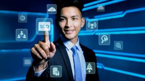 Businessman touch seo icon. On blue background Royalty Free Stock Image