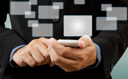 Businessman touch smart phone in hand Stock Photo