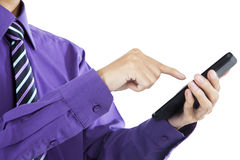 Businessman touch smart phone in hand Stock Image