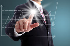 Businessman touch target point graph Stock Image