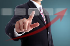 Businessman touch target point graph Stock Photo
