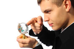 Businessman touches finger glass globe Stock Images