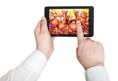 Businessman touches tablet pc with Xmas still life Royalty Free Stock Image
