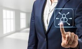 Businessman touches virtual communication icon Stock Photos
