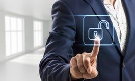 Businessman touches virtual lock icon. Stock Image
