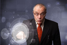 Businessman touching abstract high technology circular buttons Royalty Free Stock Images