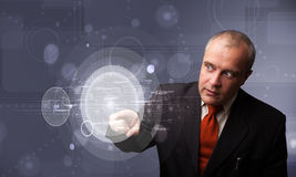 Businessman touching abstract high technology circular buttons Stock Photos