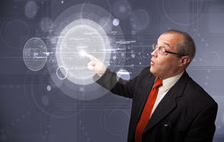 Businessman touching abstract high technology circular buttons Stock Photo
