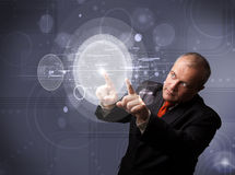 Businessman touching abstract high technology circular buttons Stock Images