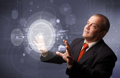 Businessman touching abstract high technology circular buttons Stock Image