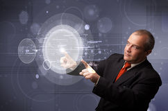 Businessman touching abstract high technology circular buttons Royalty Free Stock Photo