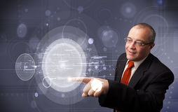 Businessman touching abstract high technology circular buttons Royalty Free Stock Photography