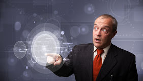 Businessman touching abstract high technology circular buttons Royalty Free Stock Photos