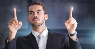 Businessman touching air glow. Digital composite of Businessman touching air glow Stock Photography